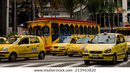 MEDELLIN - 29TH JULY: Yellow taxies in the street on july 29th 2011 in Medellin Colombia. Taxies are an inexpensive way to travel around Medellin. - stock photo