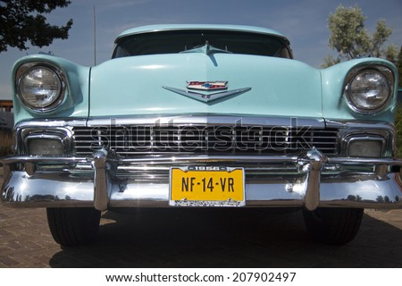 MEDEMBLIK, THE NETHERLANDS - JULY 27,2014: Front view of a Chevrolet bel air 1956  on a oldtimer show  on july 27,2014 in Medemblik