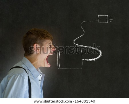 Media businessman shouting through chalk tin cup and string phone on blackboard background - stock photo