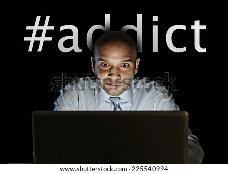 media hashtag addict text and man late night sitting at computer laptop isolated on black background on internet web social network obsession and online sites surfing  addiction concept  - stock photo