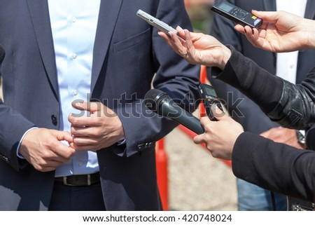 Media interview. News conference. - stock photo