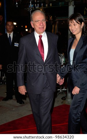Media mogul RUPERT MURDOCH & wife WENDY DENG at the Los Angeles premiere of Cast Away. 07DEC2000.   Paul Smith / Featureflash