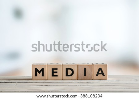 Media sign made of blocks on a wooden table - stock photo