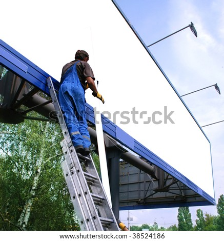 Media sign worker prepares billboard  to installing new advertisement.