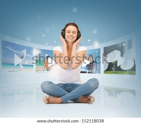 media, tv, music, enterntaiment and broadcasting concept - happy woman with headphones - stock photo