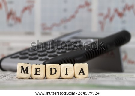 Media word built with letter cubes - stock photo