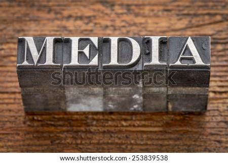media word in mixed vintage metal type printing blocks over grunge wood - stock photo