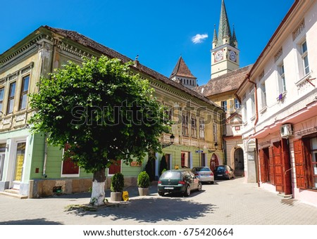 Medias, Romania - June 2017:  Medias old city centre and medieval fortified church clock tower