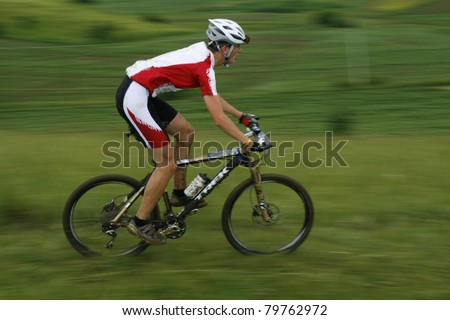 MEDIAS, ROMANIA, -JUNE 11: Unidentified mountainbiker during competition on June 11, 2011 at Medieval Mountainbike Marathon in Medias, Romania.