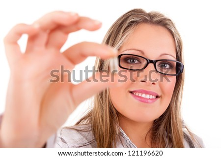 Medic holding some pills, isolated over white - stock photo