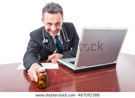 Medic smiling and writing prescription and handing bottle of pills isolated on white background