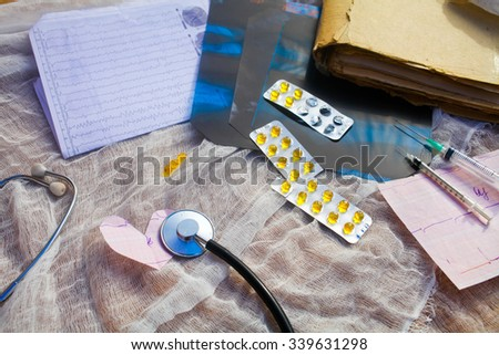 Medical accessories on a background of gauze.