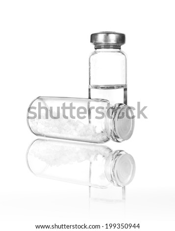 Medical ampoules with reflection isolated on white - stock photo