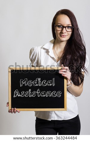 Medical Assistance - Young businesswoman holding chalkboard - vertical image - stock photo