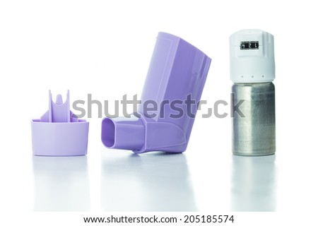 Medical Asthma inhaler isolated on white background - stock photo