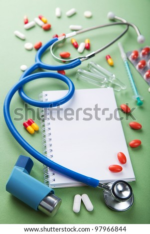 medical background with notebook - stock photo
