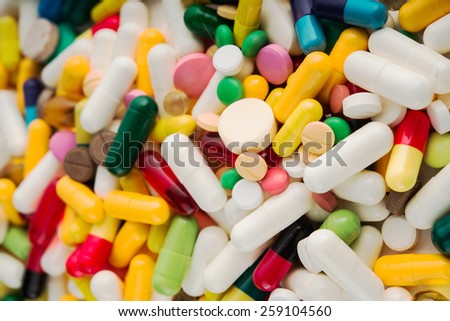 Medical background with pills and capsule - stock photo