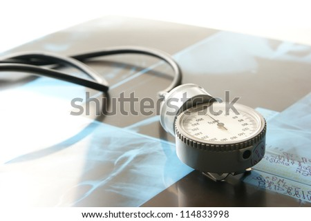Medical background with some stuff over the x-ray background - stock photo