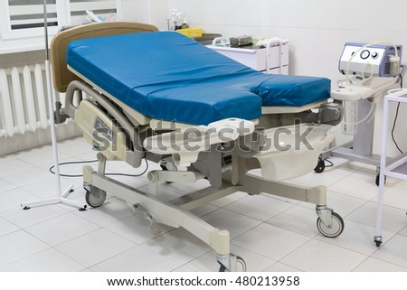 Medical bed in labour room at modern hospital