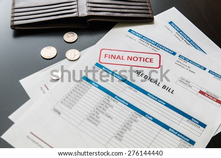 Medical bill from the hospital, concept of rising medical cost, selective focus.  All data on the bill and form design are fictional, created specially for this concept. - stock photo