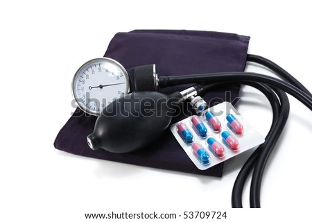 Medical blood pressure with pills isolated on white background
