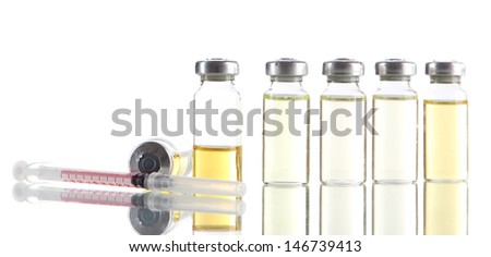 Medical bottle and syringe isolated on white