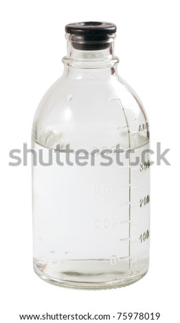 Medical bottle with scale isolated on white - stock photo