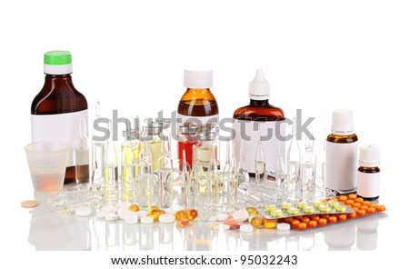 Medical bottles with medical ampoules and tablets isolated on white