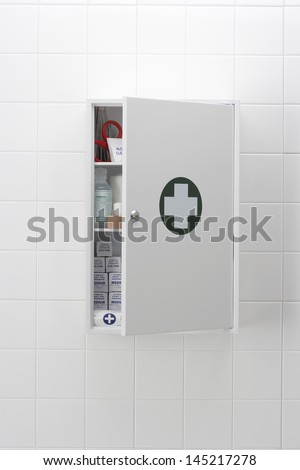Medical cabinet on wall - stock photo