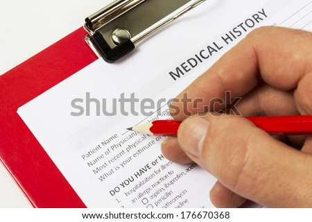 Medical claim form and patient medical history questionnaire - stock photo