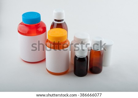 Medical colorful plastic bottles for pills and capsules on white background