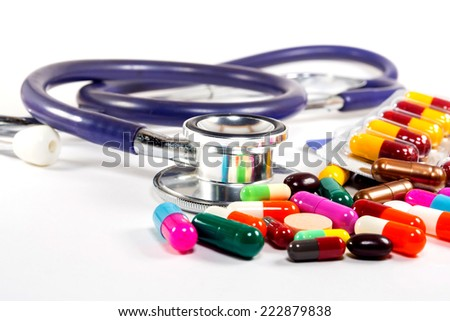 Medical concept  Doctors Stethoscope With  Colorful  Pills on white background - stock photo