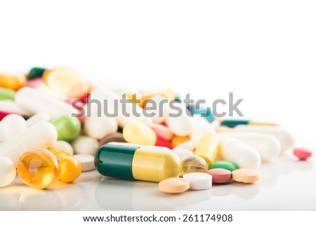 Medical concept of green capsule pills isolated on white background - stock photo