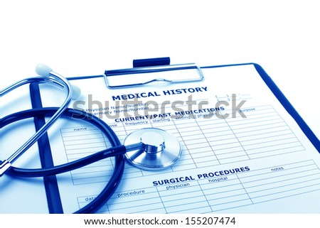 Medical concept : stethoscope and medical history form on clipboard.