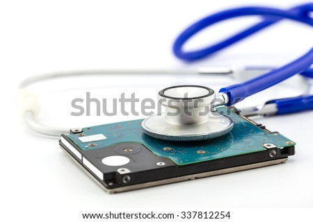Medical concept, stethoscope with computer hdd - stock photo