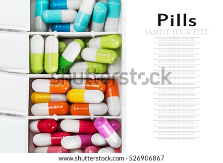 Medical container with various pills in different colors isolated on white background. delete text