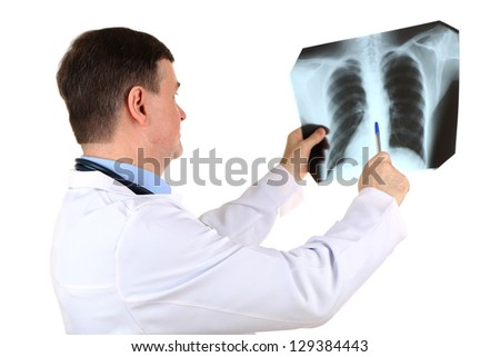 Medical doctor analysing x-ray image  isolated on white