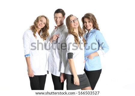 Medical doctor and beautiful nurse / Four young attractive doctors in white, blue aprons on a white background
