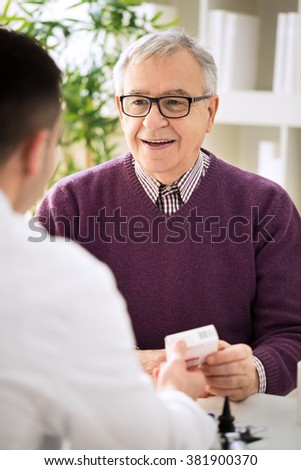Medical doctor consulting senior patient about medicines - stock photo