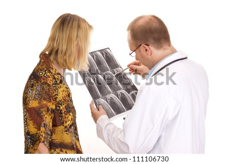 Medical doctor examining a patient - stock photo