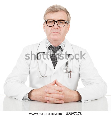 Medical doctor his hands above table - 1 to 1 ratio image - stock photo