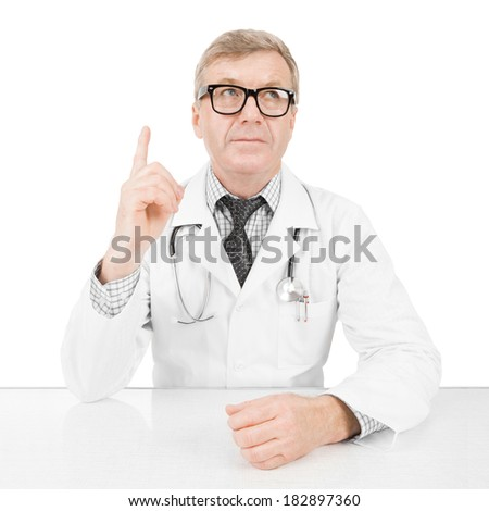 Medical doctor holding one hand above table - Concept and ideas - 1 to 1 ratio image - stock photo