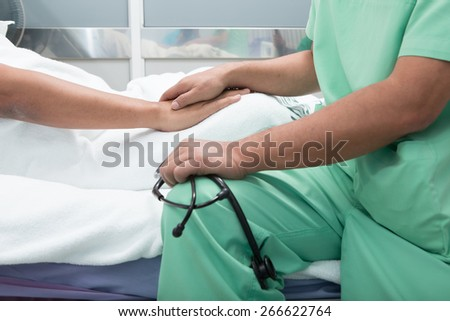 medical doctor holing senior patient's hands - stock photo