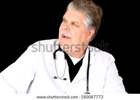 Medical doctor in lab coat talking looking sideways