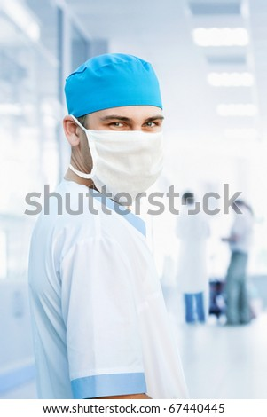 medical doctor in mask in hospital