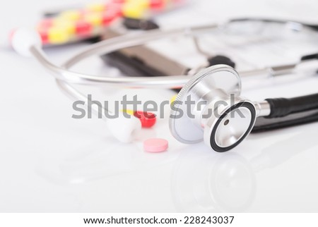 Medical doctor insurance and healthcare concept: clipboard with prescription medicine drug claim form, stethoscope