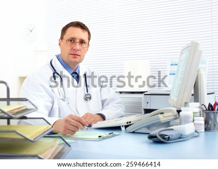 Medical doctor man in health care clinic. - stock photo