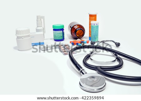 Medical doctor.medicine,bottle ,stethoscope,isolated on the white background. - stock photo