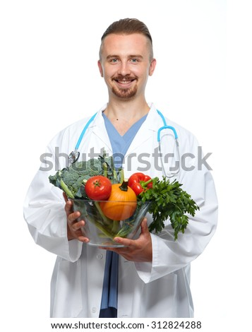 Medical doctor nutritionist with vegetables. Weight loss. - stock photo