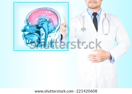 Medical doctor pointing magnetic resonance of human brain scan on virtual screen for diagnose pain - stock photo